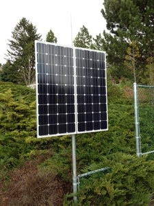 Solar panels moounted vertically on a pole