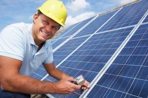 Solarwyse Guy performing maintenance on a solar array