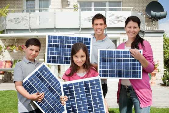 Young family showing their RV solar panels