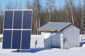 Solar array and power house working in the winter sun